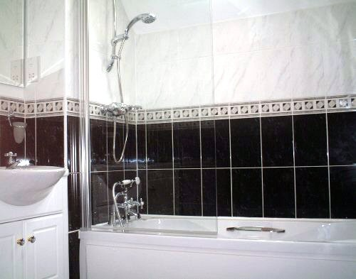 The Stunning Bathroom Has Black Wall Tiles Contrasting The White Bathroom Suite These In Turn